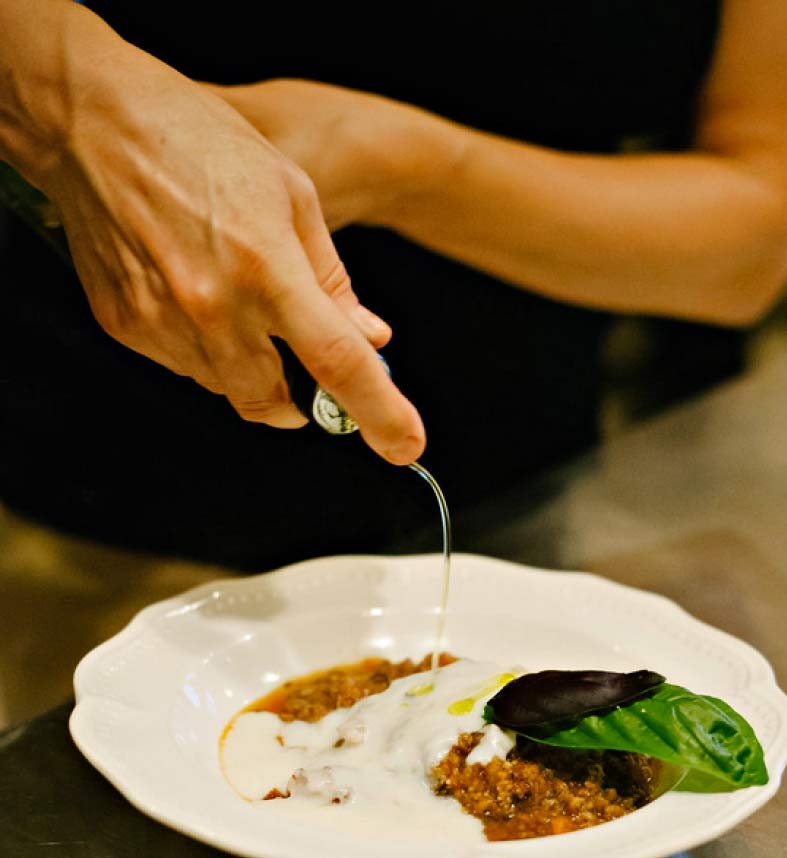 The Amber House kitchen's bolognese with bechamel, basil and olive oil