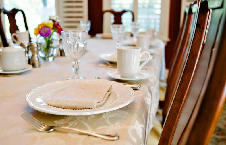 Elegant table setting for an Amber House breakfast for eight